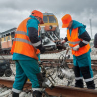 Railway workers repairing rail