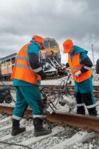 Railway workers repairing rail